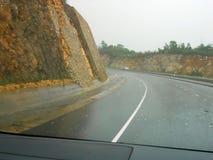 Voyage par la route de jour pluvieux images libres de droits