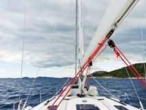 Voyage on yacht in Adriatic sea over rainy clouds. Dalmatia, Croatia Royalty Free Stock Image
