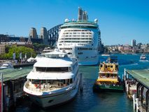 Voyager of the Seas Best Cruise Ship, captain cook cruises and Sydney ferry in one photo frame at Sydney harbour in Summer. stock photo