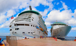 Voyager of the Seas giant cruise ship docked in the tropical port. Over 3,500 passengers went out to visit the island. Royalty Free Stock Images