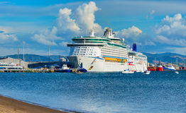 Voyager of the Seas giant luxury cruise ship was docked in port of Tauranga. Royalty Free Stock Images