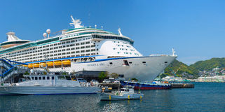 Voyager of the Seas large cruise ship was docked in the downtown of Nagasaki city. Over 3,700 passengers came to visit Japan. Stock Images