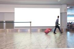 Voyageur d'aéroport avec le signe vide Photos libres de droits