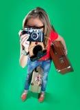Voyageuse de femme avec un appareil-photo photo stock