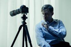 Voyeur with camera. Image of dangerous psycho voyeur with camera Royalty Free Stock Image