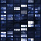 Voyeuring Office Building After Dark. In Blue Tones Royalty Free Stock Images