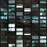 Voyeuring Office Building After Dark. In Blue Tones Royalty Free Stock Image