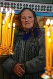 Senior woman in the Orthodox Church. VOYUTYN, UKRAINE - 14 October 2008: Ukrainian parishioner of the Orthodox Church  during the religious celebration Pokrov Royalty Free Stock Photo