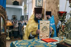 Orthodox priests and perishioners Stock Photos