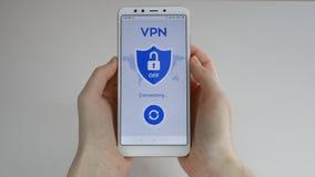 VPN Virtual Private Networks Allumer VPN sur le smartphone Cryptage des donn?es Substitut d'IP S?curit? de Cyber et banque de vidéos