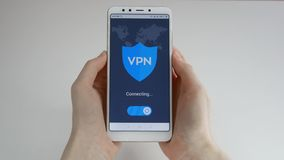 VPN Virtuelles privates Netz VPN auf dem Smartphone einschalten Daten-Verschl?sselung IP-Ersatz Internetsicherheit und stock footage
