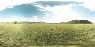 360 VR of a beautiful mountain meadow timelapse at the summer or autumn time. Clouds, green grass and sun rays. 4K 360 VR virtual Reality of a beautiful stock video footage