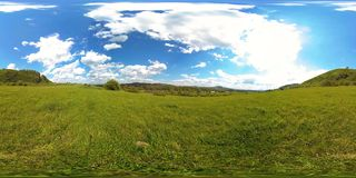 360 VR of a beautiful mountain meadow timelapse at the summer or autumn time. Clouds, green grass and sun rays. 4K 360 VR virtual Reality of a beautiful stock footage