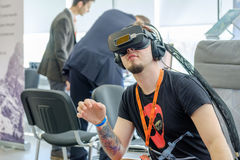 VR conference visitor tests virtual reality helmet Stock Photos