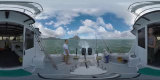360 VR Family traveling by yacht fishing on its way in the ocean, Mauritius stock video