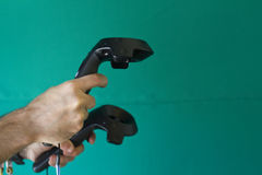 VR glasses and controls. On a green background stock photo