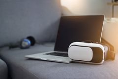 VR headset with headphone and laptop, modern technology Royalty Free Stock Image