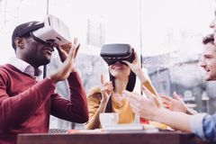 Shocked two friends exploring VR royalty free stock photography