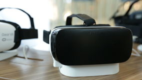 VR headsets, virtual reality sets, VR glasses. Zoom out stock video footage