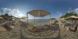 360 VR Sea and empty deck-chairs on shore. Vacation in Trikorfo Beach, Greece