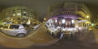 360 VR Street with cars and outdoor cafe in night Valencia, Spain stock video