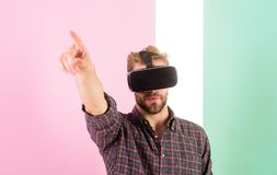 Vr technology gives new opportunities in engineering. Man unshaven guy virtual reality glasses, pink background. Hipster royalty free stock photos