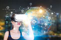 VR teen girl and a network globe stock photos