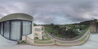 360 VR Timelapse of clouds sailing over houses near the river in Mauritius stock footage