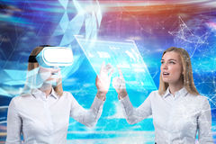 VR twins and glowing holograms, blurred Stock Image