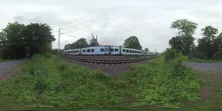 360 VR Two trains and empty road in the countryside of Frankfurt, Germany stock video footage