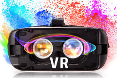 VR virtual reality glasses with colored powder. Royalty Free Stock Images
