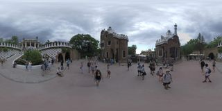 360 VR Visitors in Park Guell with gingerbread houses and Doric columns, Barcelona stock video