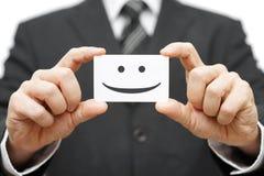Våra klienter är lyckliga klienter, leende på affärskort Royaltyfri Foto
