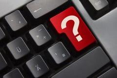 Vraagteken van de toetsenbord het rode knoop Stock Foto
