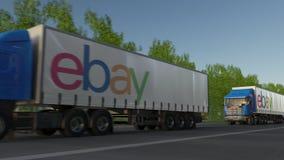 Vracht semi vrachtwagens met eBay N.v. embleem het drijven langs bosweg Het redactie 3D teruggeven Royalty-vrije Stock Foto's