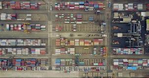 Vrachtschip en containers in industriële haven stock footage