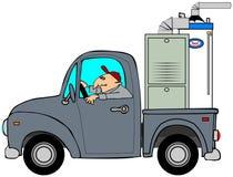 Vrachtwagen die een oven vervoert Stock Fotografie