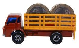 Vrachtwagen die met muntstukken wordt geladen Stock Foto