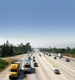 Vrachtwagens op Weg Stock Afbeeldingen