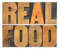 Vraie nourriture dans le type en bois d'impression typographique Images stock