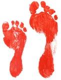 Vraies empreintes de pas d'adulte et d'enfant Photographie stock libre de droits