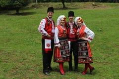 People in traditional authentic folklore costume a meadow near Vratsa, Bulgaria. Vratsa, Bulgaria - June 24, 2018: People in traditional authentic folklore royalty free stock image