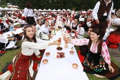 People in traditional authentic folklore costume a meadow near Vratsa, Bulgaria Royalty Free Stock Photos