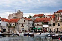 Vrboska, Croatia – July 25, 2015: Vrboska town houses and boats Royalty Free Stock Photography