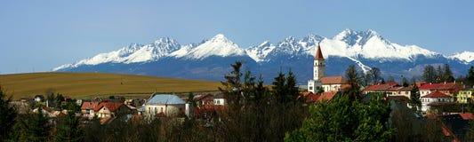 Vrbov, Spis Region, Slovakia. Slovak village Vrbov and snowy High Tatras mountains - Slovakia stock photos