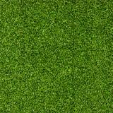 övre sikt för konstgjord fältgrästextur Royaltyfri Bild