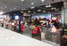 Vreedzame koffiekoffie in Oceaanterminal, Hong Kong Royalty-vrije Stock Foto