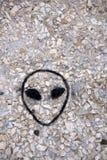Vreemd gezicht op de muur van een UFO stock foto's