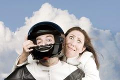Vreselijke vrouw en man op een motorfiets Stock Afbeelding