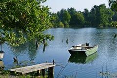 Vrhnika Slovenia fish ponds bajerji, lake boat, pier. Vrhnika`s fishpond near river Ljubljanica also known as Vrhniski bajerji Stock Photography